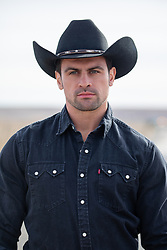 portrait of a handsome cowboy with green eyes