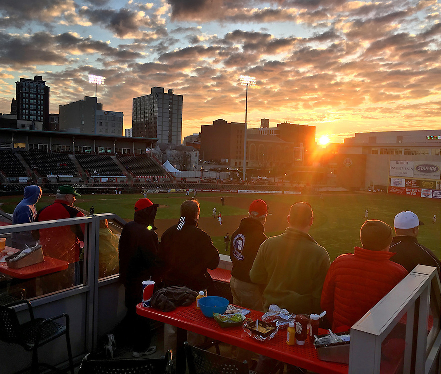 The sun sets over Jerry Uht Park as spectators right field watch the Erie SeaWolves baseball game against the Altoona Curve on May 3 in Erie. This picture was edited and originally published using Instagram. Photo by Andy Colwell/Erie Times-News