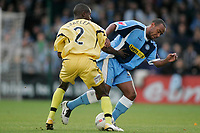 Photo: Marc Atkins.<br />Wycombe Wanderers v Oxford United. The FA Cup. 11/11/2006.<br />Eddie Anaclet of Oxford in action with Kevin Betsy of Wycombe.