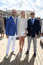 Left to right, RICK PARFITT JNR, RACHEL GRETTON and JON ZAMMETT at the Audi Polo Challenge 2013 at Coworth Park Polo Club, Berkshire on 3rd August 2013.