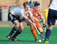 ROTTERDAM -  Samuel van Huiden   (Neth.)  with Matthew Stevenson .  Practice Match Hockey : Netherlands Boys U18  v England U18 .  COPYRIGHT KOEN SUYK