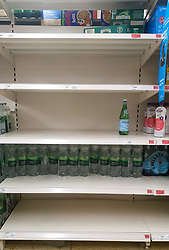 © Licensed to London News Pictures. 15/10/2021. London, UK. Nearly empty shelves of sparkling water in Sainsbury's, north London, amid fears of food shortages. The Government and retailers warn that food shortages could continue until Christmas due to labour shortages, following Brexit. Study research, conducted by delivery management experts Urbantz, reports that one in six Londoners reported that when they went food shopping, items they needed were not available and they could not find a replacement, while half of respondents said there was less variety of food in the shops than usual. Another 1-in-6 London residents were also unable to purchase fuel in the last fortnight. Photo credit: Dinendra Haria/LNP