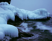 Icicles covering basalt bedrock exposed on Sugarloaf Point, Sugarloaf Point State Scientific and Natural Area, North Shore of Lake Superior, Minnesota.