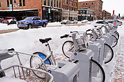 08 FEBRUARY 2021 - DES MOINES, IOWA: Rental bikes in a snowbound rack in downtown Des Moines. Central Iowa, including Des Moines, is enduring its coldest winter in 25 years. Daily high temperatures this week are not expected to go above 10F (-12C) and nightly lows are expected to be about -5F (-20C). In addition to the cold weather, this is the second snowiest winter in Des Moines history. So far this winter there has been more than 44 inches (111 centimeters) of snow. Des Moines normally gets about 35 inches (90 centimeters) of snow all winter.         PHOTO BY JACK KURTZ