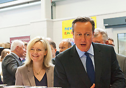 © Licensed to London News Pictures. 21/07/2014. Llanelwedd, UK. David Cameron and Liz Truss - newly appointed Secretary of State for Environment, Food and Rural Affairs since 2014 visit the food hall at the show.  A record numbers of visitors in excess of 240,000 are expected this week over the four day period of Europeís largest agricultural show. Livestock classes and special awards have attracted 8,000 plus entries, 670 more than last year. The first ever Royal Welsh Show was at Aberystwyth in 1904 and attracted 442 livestock entries. Photo credit: Graham M. Lawrence/LNP