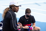 Serena Williams of the U.S. puts on her shoes in preparation for a practice session during the 2021 Australian Open at Melbourne Park in Melbourne, Australia.
