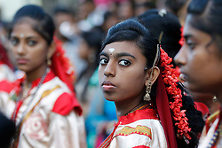 © Licensed to London News Pictures. 23/01/2016 Ipoh, Malaysia. Dancers look on as they wait for the arrival of the chariot carrying the deity Lord Murugan on its way to the Kallumalai Murugan Temple in Ipoh, Malaysia, during the Thaipusam Festival, Saturday, Jan. 23, 2016. Photo credit : Sang Tan/LNP