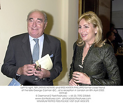 Left to right, MR JARVIS ASTAIRE and MISS KAREN PHILLIPPS former close friend of the late George Carman QC., at a reception in London on 8th April 2002.<br />OYR 60