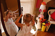 A little girl plays dress ups, Memphis, Tennessee.