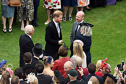 The Duke of Sussex greets guests during a Royal Garden Party at Buckingham Palace in London.
