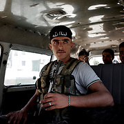 August 09, 2012 - Aleppo, Syria: A group of Free Syria Army (FSA) fighters leave their headquarters in Haneno neighborhood, to join their comrades on the frontline at Salehedine...The Syrian army and the FSA have in the past week exchanged heavy fire in a battle for the control of Syria's economic capital, Aleppo.
