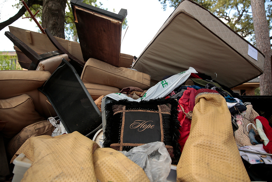 """A pile of destroyed property surrounds a pillow with the word """"Hope"""" inscribed on it in the aftermath of tropical storm Harvey in west Houston, Texas, U.S. September 11, 2017. This neighborhood flooded after controlled releases from Addicks Reservoir and neighboring Barker reservoir."""