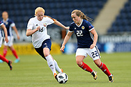 Erin Cuthbert (#22) of Scotland drives the ball forward pursued by Ksenia Kubichnaya (#16) of Belarus during the FIFA Women's World Cup UEFA Qualifier match between Scotland Women and Belarus Women at Falkirk Stadium, Falkirk, Scotland on 7 June 2018. Picture by Craig Doyle.