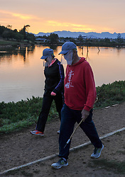 South Africa - Cape Town - 7 May 2020 - Day 42 of the National Lockdown. People wear plastic face masks during a morning walk at Sonstraal Dam in Durbanville duringLevel 4 of the National Lockdown. Level 4 allows for people to leave their homes for exercisebetween 06h00 and 09h00. South Africans are not allowed to be without a facemask in a public space during the National Lockdown. South Africans are in Level 4 of the National Lockdown to curb the spread of the coronavirus. Picture: Henk Kruger/African News Agency (ANA)