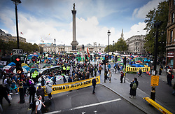 © Licensed to London News Pictures. 09/10/2019. London, UK. Extinction Rebellion activists camp out in Trafalgar Square and the surrounding roads as they take part in a third day of protests in central London. The climate change group intend to blockade the Westminster area for two weeks to demand that the government takes immediate and decisive action on climate change. Photo credit: Peter Macdiarmid/LNP