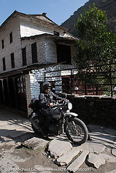 Kiwi Mike Tomas on the main street of Tatopani starting out on Day-7 of our Himalayan Heroes adventure riding from Tatopani to Pokhara, Nepal. Monday, November 12, 2018. Photography ©2018 Michael Lichter.