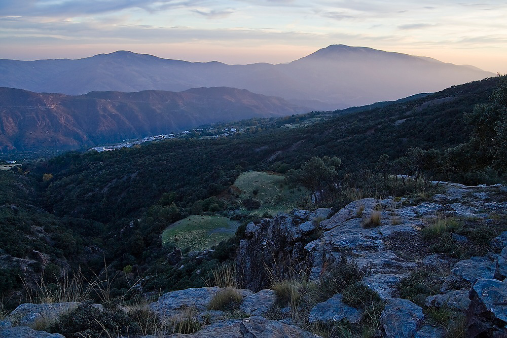 View at sunset over the Alpujarras from the foothills of the Sierra Nevada mountains, Andalusia, Spain. The town of Pitres is just barely visible in the valley below.