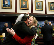 TALLAHASSEE 3/4/03-Rep. Kim Berfield, R-Clearwater, laughs as she puts a bridal veil and tiara on Rep. Rene Garcia, R-Hialeah, prior to the start of the session  Tuesday at the Capitol in Tallahassee. Berfield said the veil was left on her desk by a friend who was joking about how they were both married to their jobs. COLIN HACKLEY PHOTO