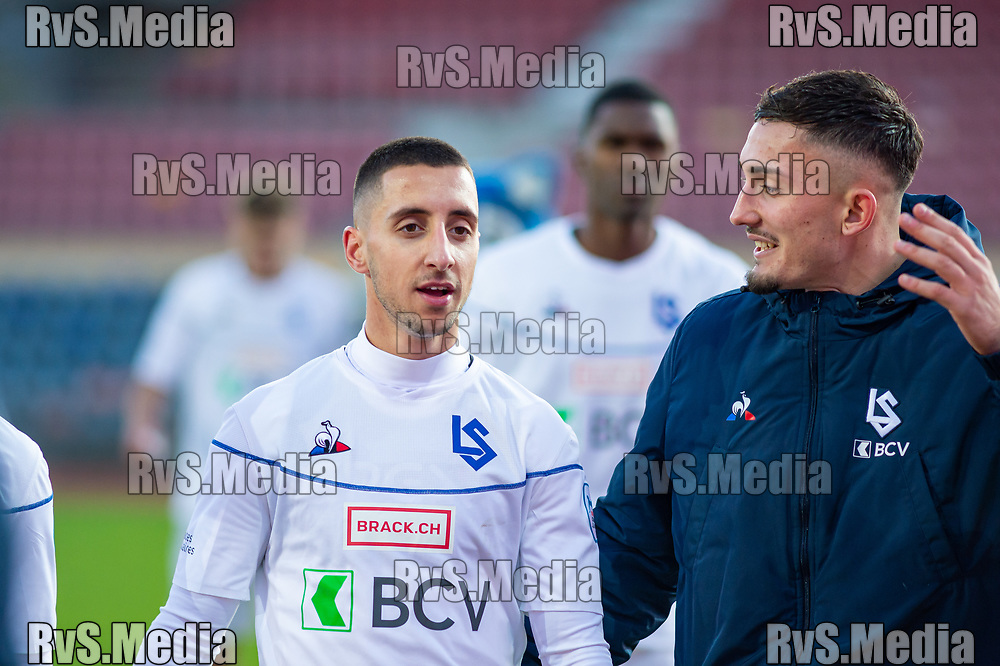 LAUSANNE, SWITZERLAND - NOVEMBER 10: #17 Joao Oliveira of FC Lausanne-Sport talks to #9 Andi Zeqiri of FC Lausanne-Sport after the Challenge League game between FC Lausanne-Sport and FC Schaffhausen at Stade Olympique de la Pontaise on November 10, 2019 in Lausanne, Switzerland. (Photo by Monika Majer/RvS.Media)