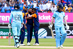 Mohammed Shami of India celebrates with teammates after taking the wicket of Eoin Morgan of England - Mandatory by-line: Robbie Stephenson/JMP - 30/06/2019 - CRICKET - Edgbaston - Birmingham, England - England v India - ICC Cricket World Cup 2019 - Group Stage