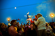 Maha Kumbh Mela, Allahbad, 24th February 2013 -  Pilgrims conduct a small arti at the banks of the Ganga at sunset, a day before the Maghi Poornima (full moon) Snan.