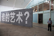 Large scale installation wall says 'Whose art is it?' on one side and 'Whose land is it?' on the other, in a gallery in 798. 798 Art Zone or Dashanzi Art District, is a part of Dashanzi in the Chaoyang District of Beijing, China that houses a thriving artistic community, among 50-year old decommissioned military factory buildings of unique architectural style. The area is often called the 798 Art District or Factory 798 although technically, Factory #798 is only one of several structures within a complex formerly known as Joint Factory 718.