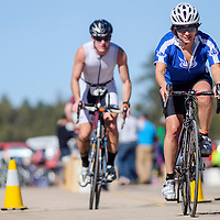 Cyclists sprint out of the final bicycle transition during the Mount Taylor Quadrathlon in Grants Saturday.