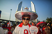 01 MARCH 2013 - BANGKOK, THAILAND: .Pheu Thai supporters wait to see Pongsapat Pongchareon, the PT candidate for governor of Bangkok at the last Pheu Thai campaign rally for the Bangkok Governor's election. The election is Sunday, March 3 and no campaigning is allowed 24 hours before election day. Police General Pongsapat Pongcharoen (retired), a former deputy national police chief who also served as secretary-general of the Narcotics Control Board is the Pheu Thai Party candidate in the upcoming Bangkok governor's election. He resigned from the police force to run for Governor. Former Prime Minister Thaksin Shinawatra reportedly personally recruited Pongsapat. Most of Thailand's reputable polls have reported that Pongsapat is leading in the race and likely to defeat Sukhumbhand Paribatra, the Thai Democrats' candidate and incumbent. The loss of Bangkok would be a serious blow to the Democrats, whose national base has been the Bangkok area.    PHOTO BY JACK KURTZ