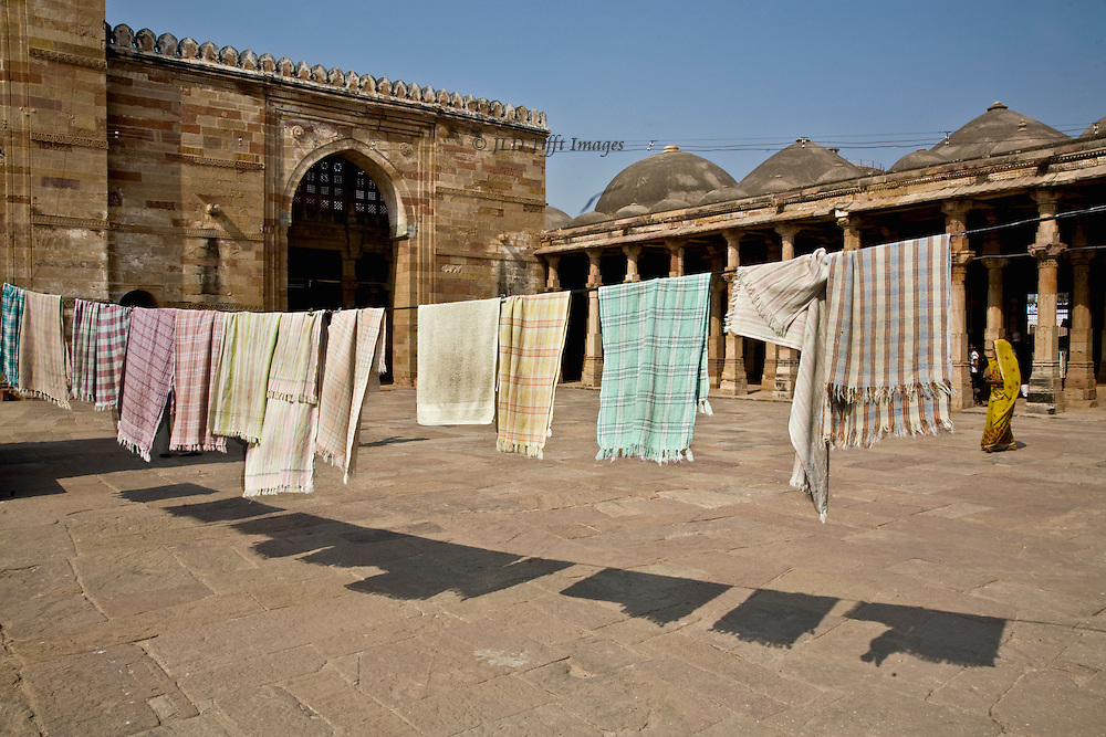 Turban wraps and towels hung to dry in the courtyard of the Sultan Ahmad Shah 1, Ahmedabad.