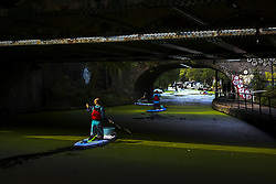 July 26, 2018 - London, United Kingdom - The Regent Canal's surface is covered by green duck weed as kayakers clean the waterway from plastic garbage, London on July 26, 2018. The heatwave caused an increase of the green duck weed in all the London waterways. (Credit Image: © Alberto Pezzali/NurPhoto via ZUMA Press)