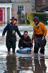 © Licensed to London News Pictures. 25/02/2020. Shrewsbury, Shropshire, UK.People get ferried over the flood waters.  River Severn levels continue to rise at Shrewsbury in Shropshire, UK causing severe flood disaster situation. The Environment Agency forecast levels to peak thisevening at. The level at 09.00hrs at Welsh ridge was 5.04 metres. Photo credit: Graham M. Lawrence/LNP