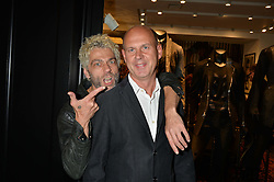Left to right, TIM NOBLE and FERGUS LAWLER at a party to celebrate the launch of the first European John Varvatos Store, 12-13 Conduit Street, London held on 3rd September 2014.