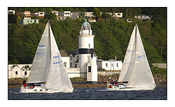 Yachting- The start of the Bell Lawrie Scottish series 2002 at Gourock racing overnight to Tarbert Loch Fyne where racing continues over the weekend.<br /><br />Bragar First 33.7 GBR6451T and Guilty Gibsea 114 1472C of class 5 pass the Cloch Lighthouse<br /><br /><br />Pics Marc Turner / PFM