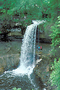 Friends age 20 hiking in back of Hidden Falls one of the many waterfalls in the Twin Cities.  St Paul Minnesota USA