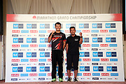 Yuma Hattori (left) poses with coach Toshinobu Sato after placing second in the men's race in 2:11:36 during the Marathon Grand Championship, Sunday Sept. 15 2019, in Tokyo. (Agence SHOT/Image of Sport via AP)
