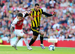 Watford's Etienne Capoue feels pressure from  Arsenal's Lucas Torreira