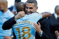 Manchester City Chairman Khaldoon Al Mubarak (right) celebrates with Fernandinho after the Premier League match at the Etihad Stadium, Manchester.