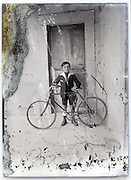 eroding glass plate with boy proudly posing with bicycle