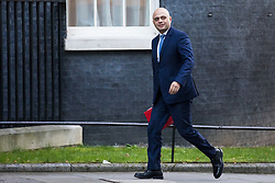 © Licensed to London News Pictures. 19/12/2017. London, UK. Secretary of State for Communities and Local Government Sajid Javid arrives on Downing Street for the weekly Cabinet meeting. Photo credit: Rob Pinney/LNP