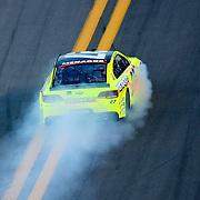 NASCAR Sprint Cup driver Paul Menard (27) catches fire during the NASCAR Coke Zero 400 Sprint series auto race at the Daytona International Speedway on Saturday, July 6, 2013 in Daytona Beach, Florida.  (AP Photo/Alex Menendez)