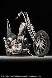 """Geezer Pleezer is a custom built chopper by Kyle Brewer of Carson City NV. Kyle's custom built rigid frame is the perfect home for the 1976 Ironhead that has been """"divorced"""" from it's original transmission and mated it to a 1981 FXR 5 speed transmission. Photographed by Michael Lichter in Sturgis, SD. July 30, 2019. ©2019 Michael Lichter"""