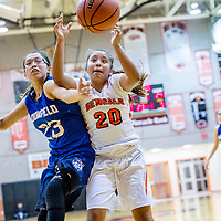 Bloomfield Bobcat Kimberlyn Morgan (23), left, and Gallup Bengal Kamryn Yazzie (20) reach for a loose ball at Gallup High School Saturday.