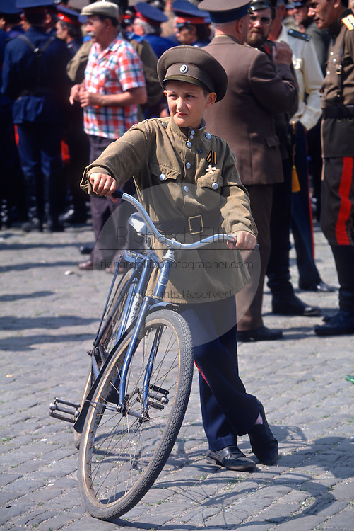 A young Russian Don Cossack with his bicycle during the annual Cossack Festival in Novocherkassk, Russia. The men are participating in the annual Cossack Festival gathering of units from around Russia.