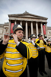© Licensed to London News Pictures. 30/12/2012. London, UK. Members of the The Marching Bulldogs, from Adrian College in Michigan USA, are seen performing in Trafalgar Square today (30/12/12) as part of a preview for London's 2012 New Years Day Parade. The parade, featuring more than 6000 performers, is set to take place on the New Year's Day, the 1st of January 2013, in the West End of London. Photo credit: Matt Cetti-Roberts/LNP