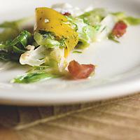 Lyonnaise Salad: black truffled cured egg sheet, warm friseé, venison marrow vinaigrette and wild boar laradon.