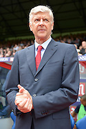 Arsene Wenger, the Arsenal manager looks on rubbing his hands  from the touchline before k/o. Barclays Premier league match, Crystal Palace v Arsenal at  Selhurst Park in London on Sunday 16th August 2015.<br /> pic by John Patrick Fletcher, Andrew Orchard sports photography.