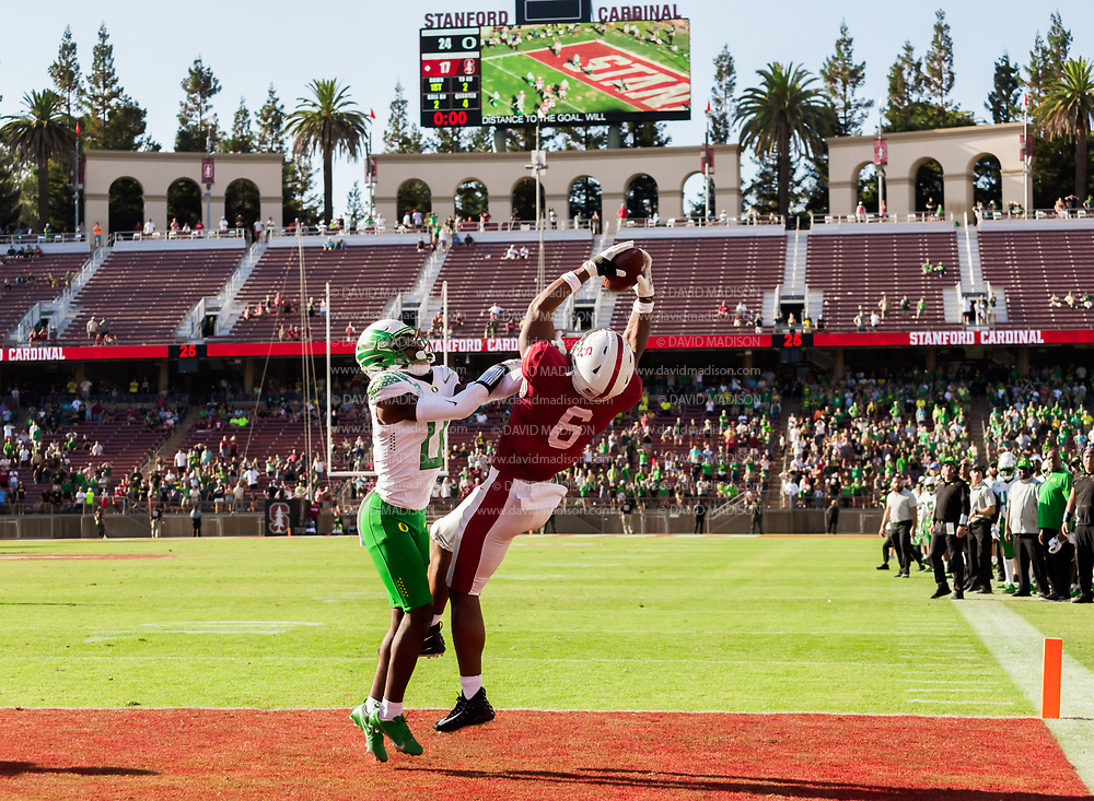 PALO ALTO, CA - OCTOBER 2:  With no time on the clock, Elijah Higgins #6 of the Stanford Cardinal catches a touchdown pass to tie the game while defended by DJ James #0 of the Oregon Ducks during an NCAA Pac-12 college football game on October 2, 2021 at Stanford Stadium in Palo Alto, California.  (Photo by David Madison/Getty Images)