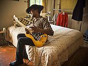 A blues guitarist, Cool John Ferguson plays his guitar at the Music Makers Organization home base in Hillsborough North Carolina.