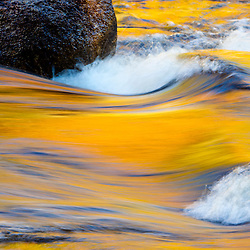 Fall colors reflected in the Swift River in New Hampshire's White Mountain National Forest.