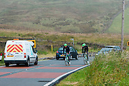 Even pro cyclists competing in the Tour de France can't escape traffic on non-race days! (Team Belkin 2014 on a practice run up Holme Moss)